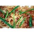 Jellyfish (海蜇, Rhopilema esculentum) garnished with slivers of green chilli and red chilli oi...