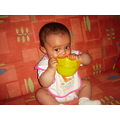 eating baby food messy girl tasting