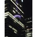 At 8:22pm.2nd Photo-close-up shot of the reflection of the CN Tower on the building-see in upurpl...