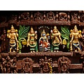 Engraved figurines on a wooden chariot in a temple in South India