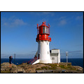 lighthouse red blue sea man cliffs photographer norway
