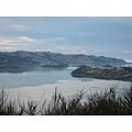 View of Otago Harbour taken from Highcliff, Dunedin.  Port Chalmers is in the centre of the photo.