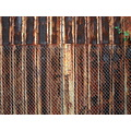rust corrosion decay color texture wall chainlink fence