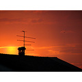 red sky sunset roof chimney antenna