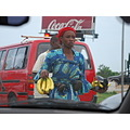 ghana accra street road car traffic food banana child coca cola