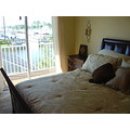 MASTER BEDROOM LOOKING OUT TOWARD DECK AND MARINA FLORIDA RENTAL
