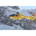 workingpeoplefriday Ischgl Austria snow mountains blue sky yellow helicopter