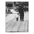 street road walk children father shadows lights bw