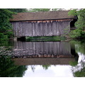 Covered bridge and water reflection