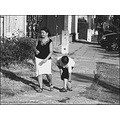 street candid walking mother boy road fence car bike summer bw