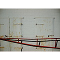 white wall hinge rust corrosion red