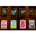flyposters advertising billboards windows rustic brickwork
