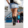 woman legs boots walking denim short skirt excel london docklands
