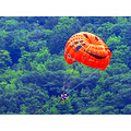 people mountain parasail