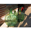 red green 2 bottles plant garden terrace home alora malaga andalucia spain