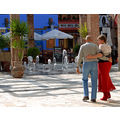 love people arm walking plaza mayor malaga spain holiday vacation couple