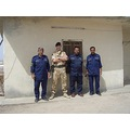 Capt Greg Colton and three members of the Oil Protection Force, guardians of the Iraqi economy.