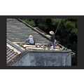 roofers on a building near by
