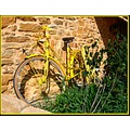 transportfriday yellow bicycle France stones house