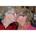 women double portrait kiss