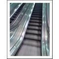 escalator train station cellphone moving travelling