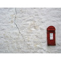 postbox whitewashed wall crack