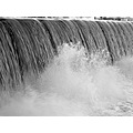 grayscale of the waterfall at the duckpond in milford.