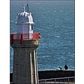 Lighthouse people fishing sea dunmore