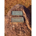 tomb grave stone winter cemetary granite boulder metal plaque