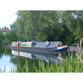 narrowboat gower reflection green and yellow red water river canal