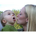baby boy mother kiss