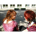 girls two red hair smiling together