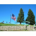 fall autumn herbst memorial veterans flag trees blue sky rocks september montana