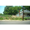 weeds overgrown vacant lot memphis tennessee chainlink fence