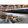 'Reflections on a Journey': A convenient puddle reflecting the roof of Newcastle Railway Station ...