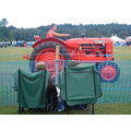 tractor country fair two old guys same hat same chair