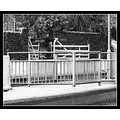 rails railings snow road crossing gate