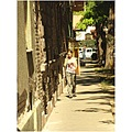 street social photo house wall windows tree road girl man car shadows