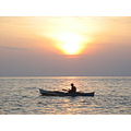 sunrise....full blown... with fisherman...