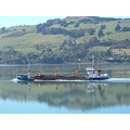 Port Otago dredge heading out to sea with a load of silt from the harbour channel.