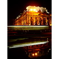 Poznanski Palace Lodz Poland night street reflection