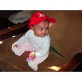 tomboy baby red cap playing toy sitting chair