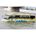 bus yellow turist water land