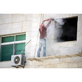 construction worker stone wall cleaning primitive scaffold dust