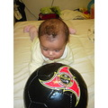 football ball black pink baby girl watching