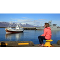 Lady waiting for the Boat concert in Reykjavik , yesterday .