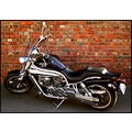 aquila motocycle chrome black brick wall reflection wheelsfriday