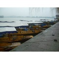China rain wet day lake boats boat water