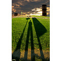 Sky long shadow green grass statue Archer