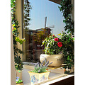 My balcony, seen from my livingroom and photografed through double glass.